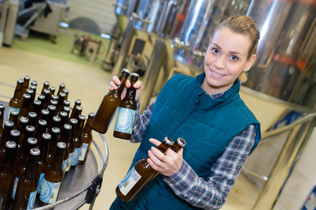 female worker in a beer bottling factory